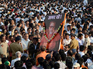 Supporters hold a placard as they follow the funeral cortege of Bal Thackeray during a procession in Mumbai on November 18, 2012. (AFP)