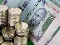 The Indian rupee recovered by 12 paise to 55.04 against the US dollar in the late morning trade today on fresh selling of the American currency by banks amid persistent capital inflows into the equity market.
