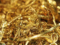Gold prices firmed up as the dollar slipped on Monday while violence in the Middle East and talks to resolve an imminent fiscal crunch in the United States lent support.
