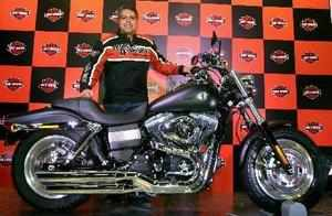 Anoop Prakash, Managing Director, Harley-Davidson India, poses with the Fat Bob motorcycle during its launch in New Delhi on Thursday.