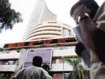 Erasing initial gains, the BSE benchmark Sensex today closed with a moderate loss of 11 points as investors turned cautious ahead of the all-party meeting on the government decision to allow foreign direct investment in retail trade.