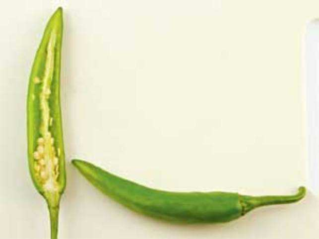 The large green chillies in a Hyderabadi mirchi ka salan are mild and act as a vessel for the flavourful gravy.