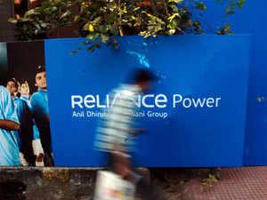 Eleven power distribution companies from Andhra Pradesh, Tamil Nadu, Karnataka and Maharashtra have slapped a fine of Rs 400 crore on Coastal Andhra Power, part of the Anil Dhirubhai Ambani Group.