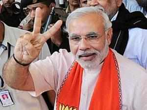 """L K Advani today termed Gujarat Chief Minister Narendra Modi as a """"role model"""" of development while appealing to states to imitate him."""
