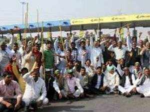 Farmers' body warned of taking over all highway toll plazas in Uttar Pradesh if the government and NHAI do not allow free passage of tractor-trolleys.