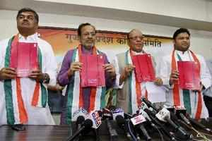 Ahmedabad: Gujarat Congress incharge B.K. Hariprasad with party leaders Arjun Modhwadia, Shankarsingh Vaghela and Ashok Tanwar release the party's chargesheet against Chief Minister Narendra Modi and his government at a press conference in Ahmedabad on Monday. (PTI)
