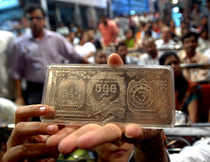 Taking weak cues from global markets and subdued spot demand, silver futures prices today fell by 1.44 per cent to Rs 62,313 per kg.