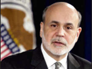 Chairman Ben Bernanke moved the Federal Reserve further into uncharted policy territory in combating joblessness by tying the bank's interest-rate outlook to unemployment and inflation, while committing to an even faster expansion of the central bank's balance sheet.
