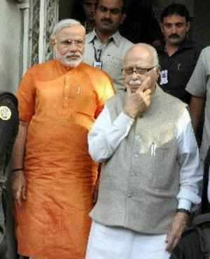 BJP senior leader LK Advani and Gujarat Chief Minister Narendra Modi at the party headquarters in Ahmedabad on Monday. (PTI photo)