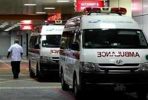 Ambulances are parked outside the accident and emergency entrance at Mount Elizabeth Hospital in Singapore.(AP Photo)