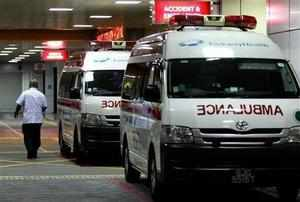 Ambulances are parked outside the accident and emergency entrance at Mount Elizabeth Hospital in Singapore.   The 23-year-old Delhi gang rape victim had expressed her intention to live and wanted her tormentors to be brought to justice. (AP Photo)