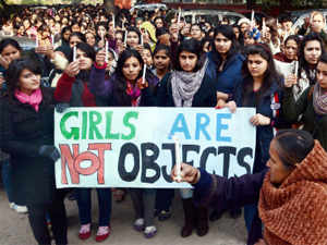 Students take part in a candle light march demanding justice for the 23-yr-old gang-rape victim in New Delhi. (PTI Photo)