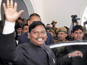 Jharkhand Chief Minister Arjun Munda waves after tendering his resignation to Governor Syed Ahmed at Raj Bhavan in Ranchi. (PTI)