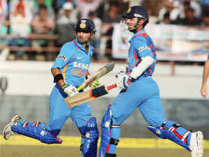 India's Gautam Gambhir and Ajinkya Rahane runing between wicket during the first ODI cricket match against England in Rajkot on Friday. PTI
