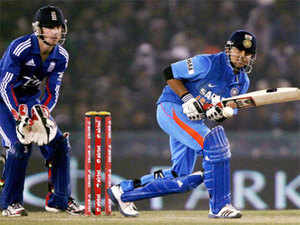 Suresh Raina plays a shot against England during the 4th ODI cricket match at PCA Stadium at Mohali on Wednesday, January 23, 2012. (PTI)