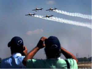 Spectators watch an air show during the opening of the Aero India 2013 at Yelahanka air base in Bengaluru on Wednesday.