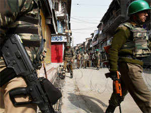 Security personnel patrolling a street on the third consecutive day of curfew imposed by the authorties to prevent law and order problem after the execution of Parliment attack convict Afzal Guru, in Srinagar on Monday. PTI
