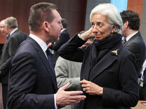 Greek Finance Minister Yannis Stournaras, left, talks with International Monetary Fund managing director Christine Lagarde, during the Eurogroup meeting, at the European Council building in Brussels.