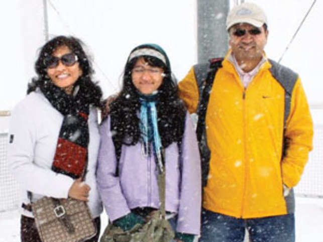 Ajay Bakshi at Jungfraujoch, Switzerland, with daughter Parvathi and wife Asha.