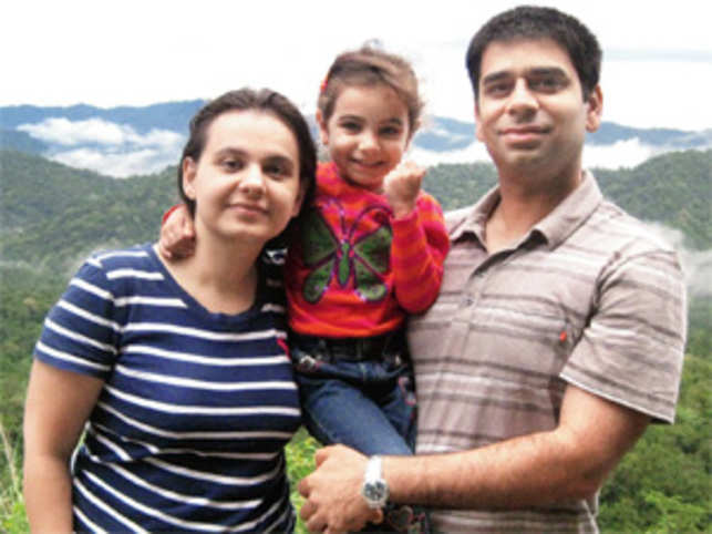 Akshay Bhalla, MD, Protiviti Consulting with family