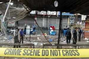 Twin blasts ripped through a crowded market in Hyderabad yesterday, leaving 16 dead and 120 injured.