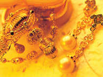 Gold climbs up at the bullion market on emergence of fresh demand from stockists and retailers at existing levels amidst bullish global cues.