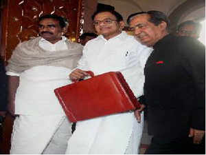 Union Finance Minister P Chidambaram with Ministers of State NN Meena and SS Palanimanickam arrives at Parliament to present the Annual Budget 2013-14 in New Delhi on Thursday. Apart from making allocations for exclusive sub plans for scheduled castes and scheduled tribes, Budget also has special plans for minorities, women and children as well as persons with disabilities.