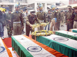 Director General of Jammu and Kashmir Police Ashok Prasad laying wreath on the coffins containing the dead bodies of five CRPF Jawans,who were killed during the recent encounter with militants at Bemina, at DPL in Srinagar on March