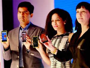 Director, Smart Devices, Vipul Mehrotra (L), fashion designer Masaba Gupta (C) and Vice President Nikki Barton launch Nokia Lumia 720 smartphone in New Delhi on March 20, 2013. PTI