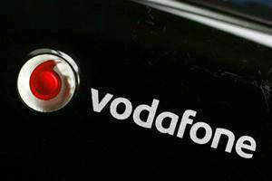 Vodafone adopts IFRS accounting; restates results