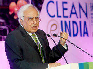 The MoU was signed in the presence of Mr. Kapil Sibal. Under this project, all villages of State will be covered under National Optical Fiber Network. (Pic by PTI)
