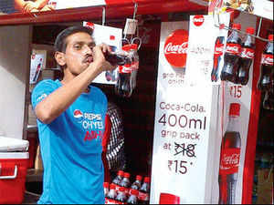 Step out of the stadium in Delhi or Chennai and you'll find hundreds of cricket fans sipping on Coca-Cola bottles, like the gentleman in a Pepsi T-shirt in the photograph