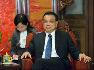 Choosing India as the first stop of the premier's visit shows China's will to improve bilateral ties, but the current standoff may cast a shadow on the tour. (Pic by AFP)