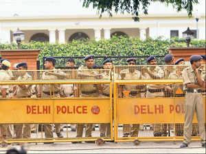 Cops outside PK Bansal's residence in New Delhi on Sunday.