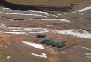 India will take up with Chinese Premier Le Kequiang the issue of the recent intrusion by the People's Liberation Army troops into Depsang valley in Ladakh and wants to push ahead with the bilateral dialogue on settling the border row. In pic: Aerial view of five tents erected by intruding Chinese troops at Daulat Beg Oldi sector of Ladakh.