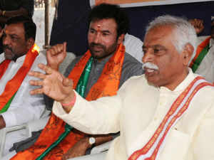 """BJP's National Vice President Bandaru Dattatreya today sought dismissal of CM N Kiran Kumar Reddy for allegedly protecting """"tainted"""" ministers."""