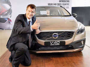 Managing Director of Volvo Auto India, Tomas Ernberg pose with the new launched 'V40 Cross Country' car in Gurgaon on Friday.