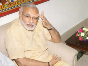 Narendra Modi met the top brass of Maharashtra BJP to discuss strategy for next LS elections but Nitin Gadkari was conspicuous by his absence.