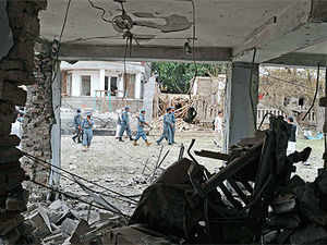 Afghan policemen at the site of a suicide attack in front of the Indian consulate in Jalalabad on August 3