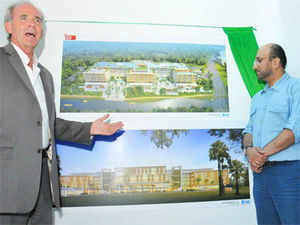 Robert Marshall,left, global director of planning & landscape at B+H Architects explaining the features of SmartCity's IT building to  AlMulla in Kochi. (File pic)