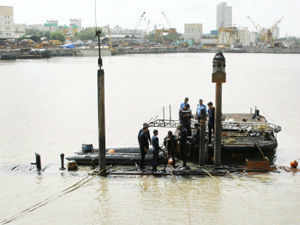 Facing tough conditions, Indian Navy divers today extricated badly charred bodies of four personnel from submarine Sindhurakshak.