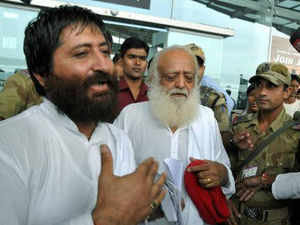 Police said medical examination of both the mediapersons will be conducted and action will be taken against those involved in the attack.  In pic: Asaram Bapu and his son Narayan Sai coming out from Raja Bhoj Airport after they missed the flight, in Bhopal on Friday.