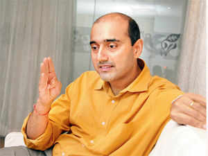 Bharti Airtel, CEO Gopal Vittal says he is awaiting clarity on norms governing mergers and acquisitions in the telecom sector.