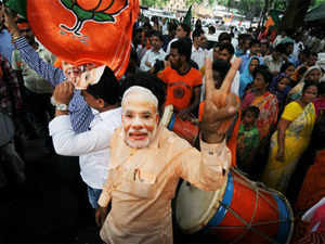 Celebrations kicked off across Gujarat as soon as Rajnath Singh announced Narendra Modi as the party's face for 2014, with common citizens, shop-keepers and assorted Modi fan clubs distributing sweets and bursting firecrackers.