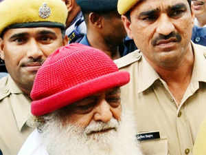 A key accused and associate of controversial self-styled godman Asaram Bapu today surrendered before a court