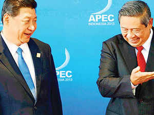 Indonesian President Susilo Bambang Yudhoyono (right) with Chinese President Xi Jinping at the Apec Summit in Bali. Jinping has been winning friends even among traditional sceptics about China such as Indonesia.