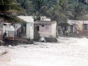 Rough waves hit the fishermen colony Siva Ganeshnagar near Kailasagiri due to the Cyclone Phailin in Visakhapatnam on Saturday.