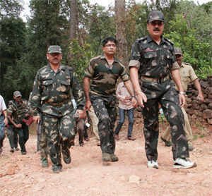 Ten people including three police commandos were killed today in two separate attacks by Maoists in Maharashtra and Bihar.