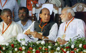 Gujarat CM and BJP's Prime Ministerial candidate Narendra Modi with party President Rajnath Singh and Kalyan Singh at public during his election campaign rally in Kanpur on Saturday.
