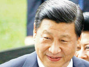 China's president Xi Jinping (above right) has begun investigating Jiang Jiemin, a politician who was a former chairman of the China Natural Petroleum Corporation